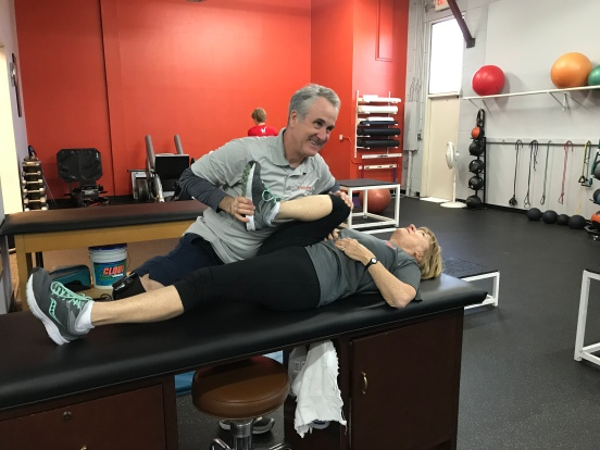 John Neel stretching Joanne Young